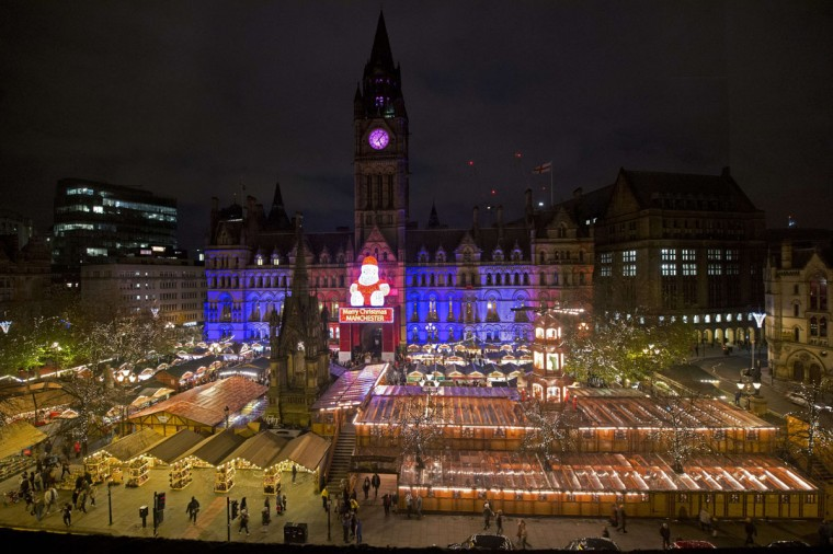 Manchester's Town Hall is illuminated in blue, white and red lights, resembling the colors of the French national flag, in Manchester, north west Enlgand on November 15, 2015, as Britons express their solidarity with France following a spate of coordinated attacks that left over 120 dead in Paris on November 13. (OLI SCARFF/AFP/Getty Images)