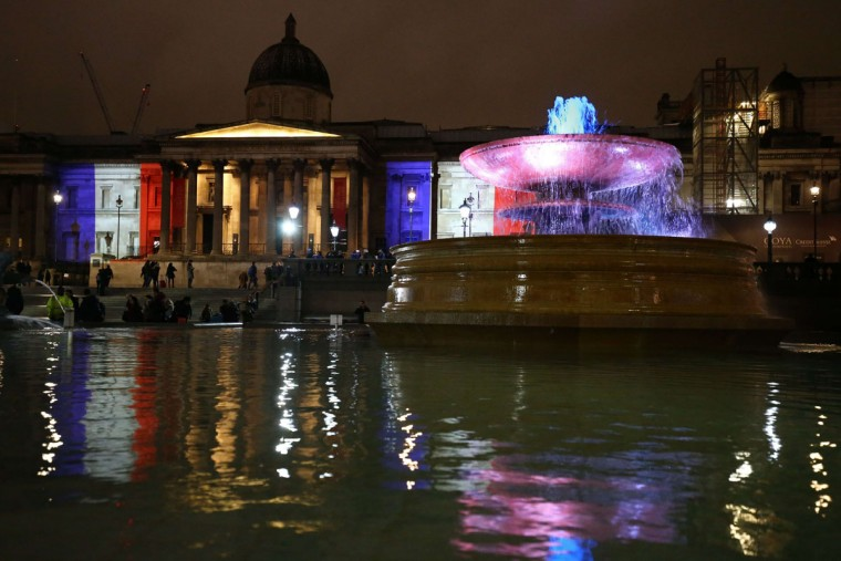 London's National Gallery and the fountains in Trafalgar Square are illuminated in blue, white and red lights, resembling the colors of the French national flag, in London on November 14, 2015, as Britons express their solidarity with France following a spate of coordinated attacks that left 129 dead in Paris on November 13. (JUSTIN TALLIS/AFP/Getty Images)