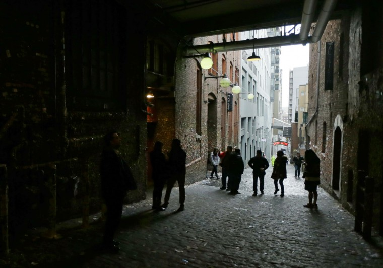 Visitors walk through the alley housing Seattle's famous gum wall at Pike Place Market, Monday, Nov. 9, 2015. (AP Photo/Ted S. Warren)