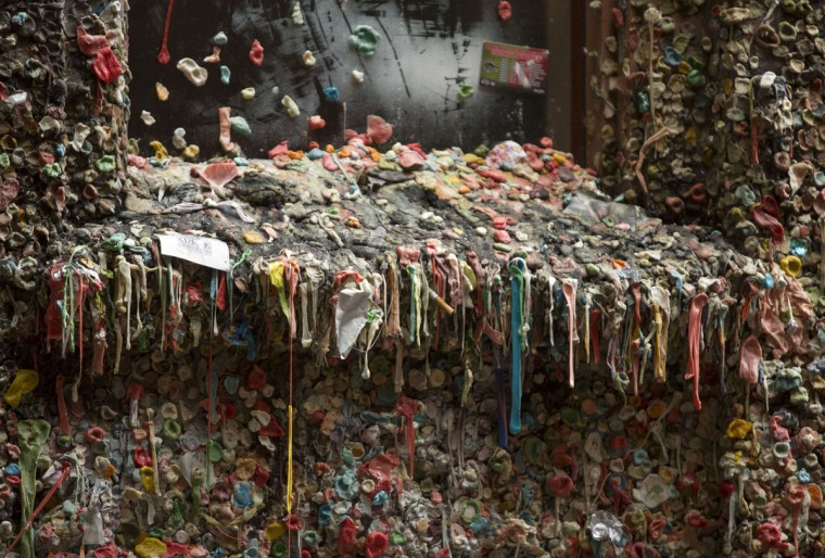 Twenty years worth of chewing gum is pictured before its removal in Post Alley at the Pike Place Market in Seattle, Washington on November 11, 2015. (JASON REDMOND/AFP/Getty Images)