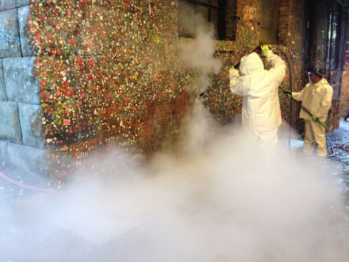 Workers steam-clean gum off Seattle's famed Gum Wall on Tuesday, Nov. 10, 2015 in Seattle. (Maria L. La Ganga/Los Angeles Times/TNS)