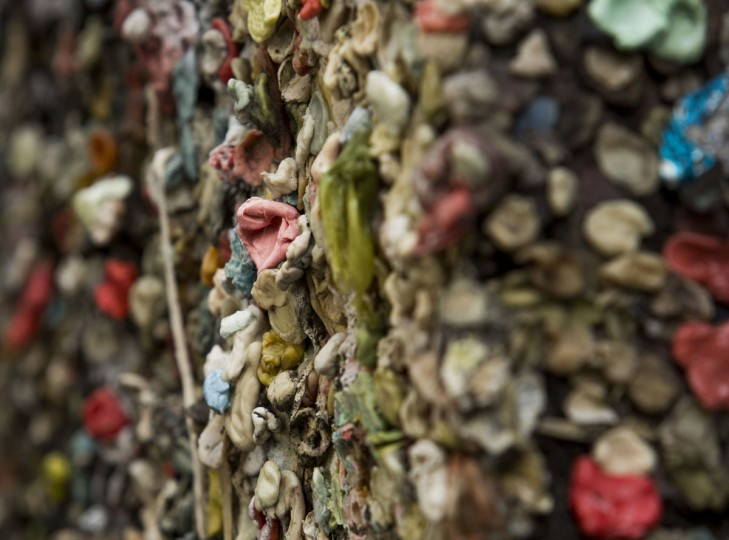 Twenty years worth of chewing gum is pictured before its removal from Post Alley at the Pike Place Market in Seattle, Washington on November 11, 2015. (JASON REDMOND/AFP/Getty Images)