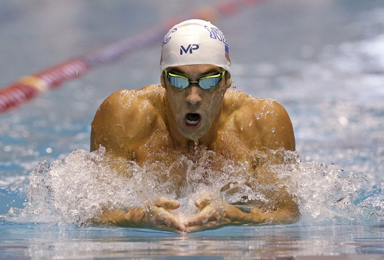 Michael Phelps swims the breaststroke leg of the men's 200 meter individual medley in a preliminary race at the U.S. Winter Nationals swimming event Thursday, Dec. 3, 2015, in Federal Way, Wash. (AP Photo/Elaine Thompson)