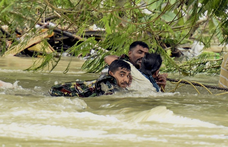 Indian army soldiers rescue a man from flood waters in Chennai, India, Thursday, Dec. 3, 2015. The heaviest rainfall in more than 100 years has devastated swathes of the southern Indian state of Tamil Nadu, with thousands forced to leave their submerged homes and schools, offices and a regional airport shut for a second day Thursday. (R Senthil Kumar / Press Trust of India via AP)