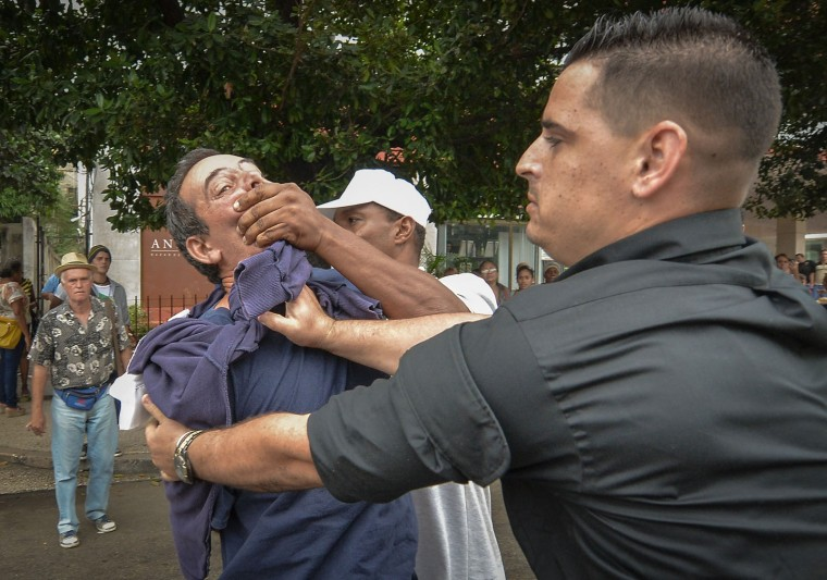 Cuban opponent to the government, Yuri Valle Roca, is arrested by Cuban police on December 10, 2015 in Havana during a demo for the Human Rights Day. (Adalberto Roque/AFP/Getty Images)
