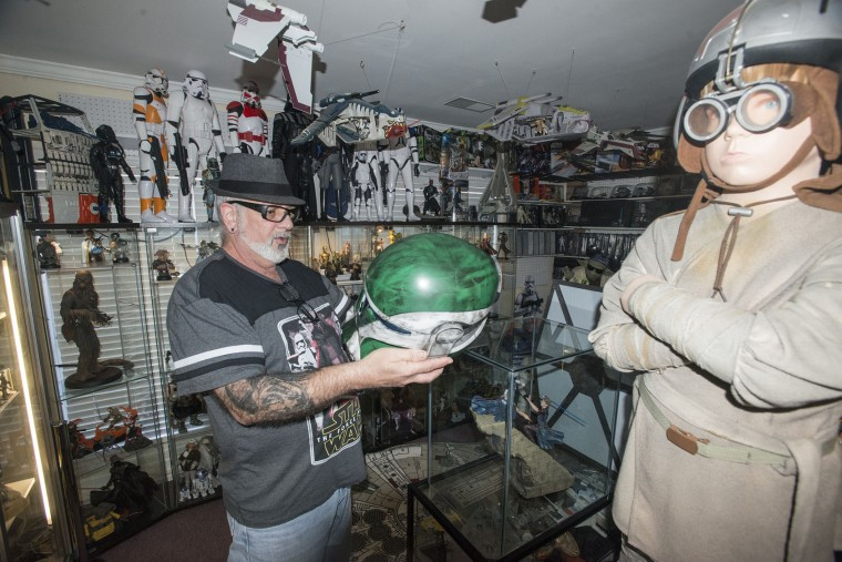 "In this photo taken Monday, Dec. 14, 2015, Mike Avallone holds a life size storm trooper helmet in his Star Wars themed home in Deatsville, Ala. He and his wife Kelly Avallone are anxiously awaiting this week's release of ""Star Wars: The Force Awakens."" (Shannon Heupel/The Montgomery Advertiser via AP)"