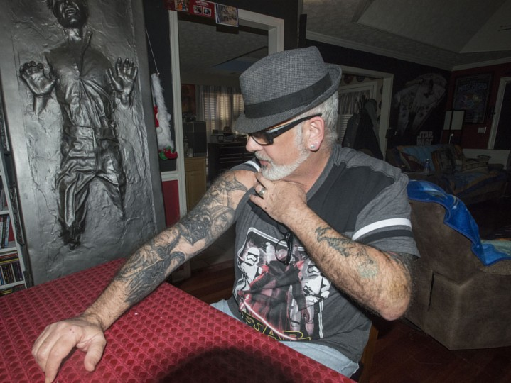 "In this photo taken Monday, Dec. 14, 2015, Mike Avallone shows his collection of Star Wars tattoos at his home in Deatsville, Ala. He and his wife Kelly Avallone live in a Star Wars themed home and are anxiously awaiting this week's release of ""Star Wars: The Force Awakens."" (Shannon Heupel/The Montgomery Advertiser via AP)"
