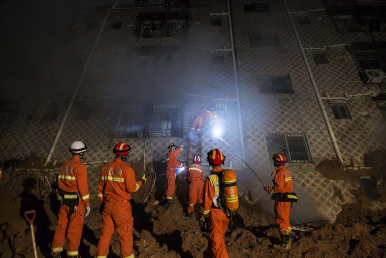 Emergency services search a collapsed building after a landslide buried 22 buildings on December 20, 2015 in Shenzhen, China. Reports say at least 27 people are missing and 7 people have been rescued so far after a landslide hit China's southern province on Sunday. (Lam Yik Fei/Getty Images)