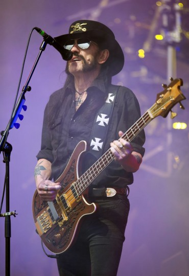 "This file photo taken on June 26, 2015 shows the lead singer and bassist for British rock band Motorhead, Ian ""Lemmy"" Kilmister, performing on the Pyramid Stage on the first official date of the Glastonbury Festival of Music and Performing Arts on Worthy Farm near the village of Pilton in Somerset, southwest England. Ian ""Lemmy"" Kilmister, the frontman of iconic British heavy metal band Motorhead, has died aged 70 of a sudden, aggressive cancer, the group said on December 29, 2015. (Oli Scarff/AFP/Getty Images)"