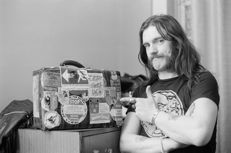 Lemmy Kilmister from Motorhead points to a tour case backstage at City Hall in Newcastle, England on March 22nd 1982. (Fin Costello/Redferns)