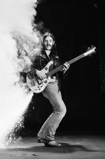 Lemmy Kilmister, British rock bassist and singer with British heavy metal band Motorhead, poses with his bass guitar with fireworks attached, firing sparks from the body, circa 1978. (Fin Costello/Redferns/Getty Images)