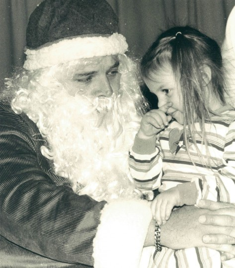 Rachel Caras, 3, sits on Santa's lap at Dasher Green Elementary School. (Baltimore Sun archives, 1988)
