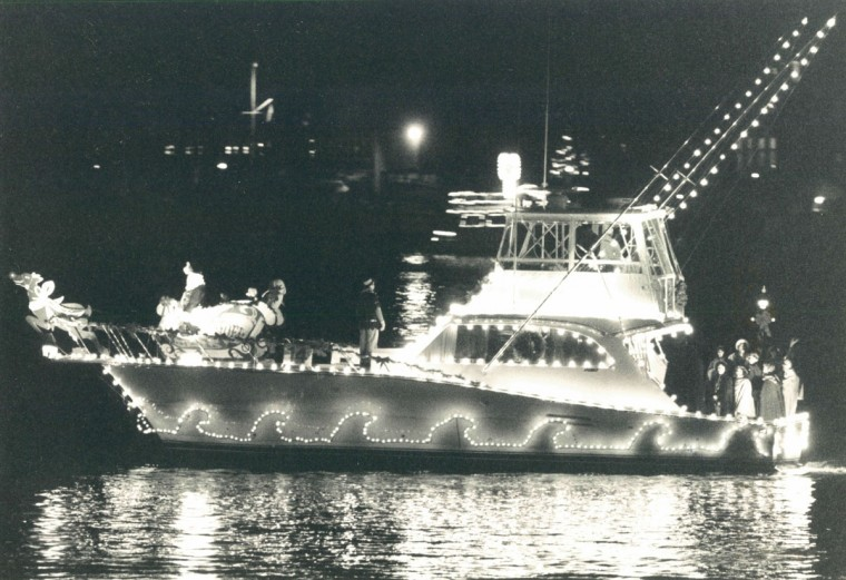 Boats strut their stuff throughout the city dock and around the harbor during the annual parade of lights in downtown Annapolis. (Karl M. Ferron/Baltimore Sun, 1988)