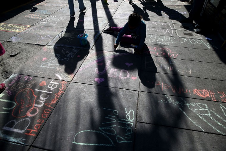 Names of people who have died of AIDS are written in chalk on Castro Street on December 1, 2015 in San Francisco, California. To commemorate World AIDS day, dozens of people used chalk to write the names of people who have died from AIDS along San Francisco's Castro Street. World AIDS Day has been observed on December 1, since 1988, and is dedicated to raising awareness of the AIDS pandemic caused by the spread of HIV infection, and to mourn those who have died from the disease. (Photo by Justin Sullivan/Getty Images)