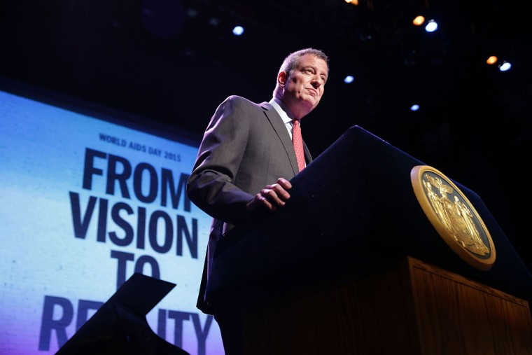 New York Mayor Bill de Blasio addresses a World AIDS Day gathering in Harlem on December 1, 2015 in New York City. The event, at the historic Apollo Theater, brought together over 60 AIDS-service and community-based organizations and the NYC Department Of Health And Mental Hygiene to celebrate World Aids Day. Cuomo announced on Monday that New York State would increase spending on AIDS programs by $200 million, on top of the $2.5 billion annually to fight against the disease in New York. It is estimated that 1.5 million people died from HIV globally in 2013. (Photo by Spencer Platt/Getty Images)