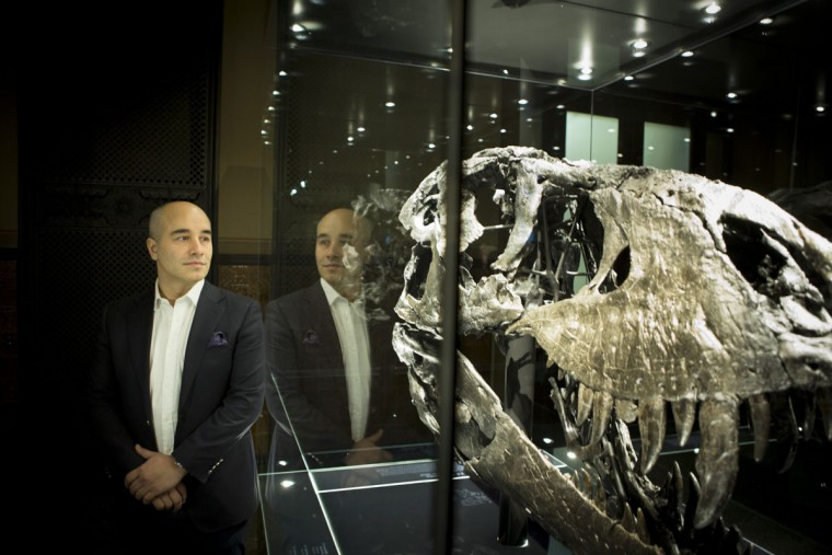 Niels Nielsen, businessman and owner of the T-Rex stands next to the scull of a Tyrannosaurus Rex during a media preview at the Museum fuer Naturkunde (Natural History Museum) on December 16, 2015 in Berlin, Germany. The skeleton, unearthed in the U.S. state of Montana in 2012, is among the best-preserved large dinosaur skeletons ever found. Tristan is approximately 66 million years old, is 12 meters long and is the first complete Tyrannosaurus Rex to ever be displayed in Europe. Tristan will be on exhibition at the Berlin natural history museum for the next three years. (Photo by Axel Schmidt/Getty Images)