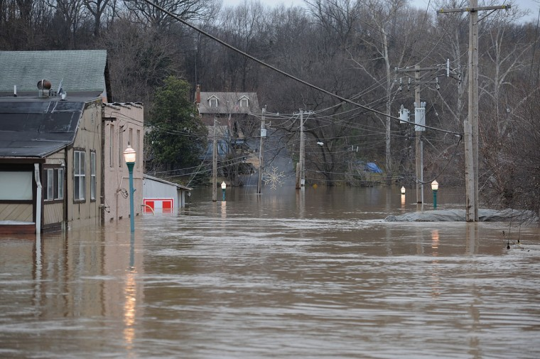 Water Street is seen fully submerged as the Meremac River rises into the town on December 30, 2015 in Fenton, Missouri. The St. Louis area and surrounding region experiencing record flood crests of the Mississippi, Missouri and Meremac Rivers after days of record rainfall. (Photo by Michael B. Thomas/Getty Images)
