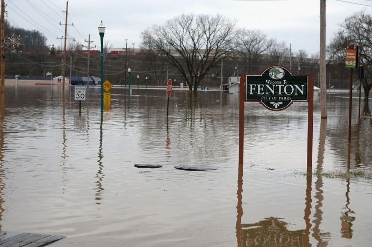 Gravios Road is seen fully submerged on December 30, 2015 in Fenton, Missouri. The St. Louis area and surrounding region experiencing record flood crests of the Mississippi, Missouri and Meremac Rivers after days of record rainfall. (Photo by Michael B. Thomas/Getty Images)