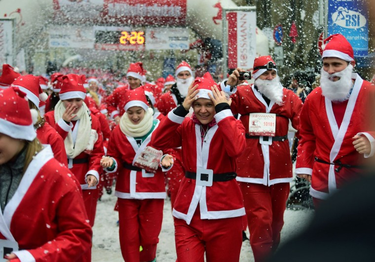 Runners wearing Santa Claus costumes participate in the 'Santa Claus Run' at the bank of Danube River in downtown of Budapest on December 6, 2015. Thousand runners took part in this year's run. (AFP Photo/Attila Kisbenedek)