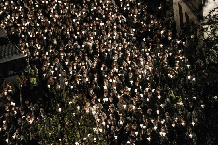 People take part in a religious procession, on December 8, 2015 in the central French city of Lyon during the 17th cancelled edition of the Festival of Lights, a secular version of a religious tradition devoted to Virgin Mary and dating back to 154 years ago. (AFP Photo/Jeff Pachoud)