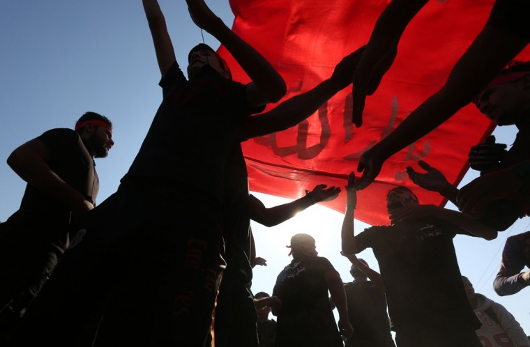 Iraqi Shiite pilgrims flagellate themselves as part of the Arbaeen ritual in Baghdad, Iraq, Sunday, Nov. 29, 2015. (AP Photo/Hadi Mizban)