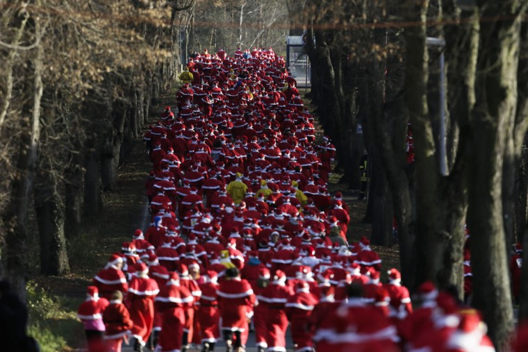Hundreds of people dressed as Santa Claus take part in the Santa Claus run in Michendorf 43 kilometers ( about 27 miles) south east of Berlin, Germany, Sunday, Dec. 6, 2015. (AP Photo/Markus Schreiber)