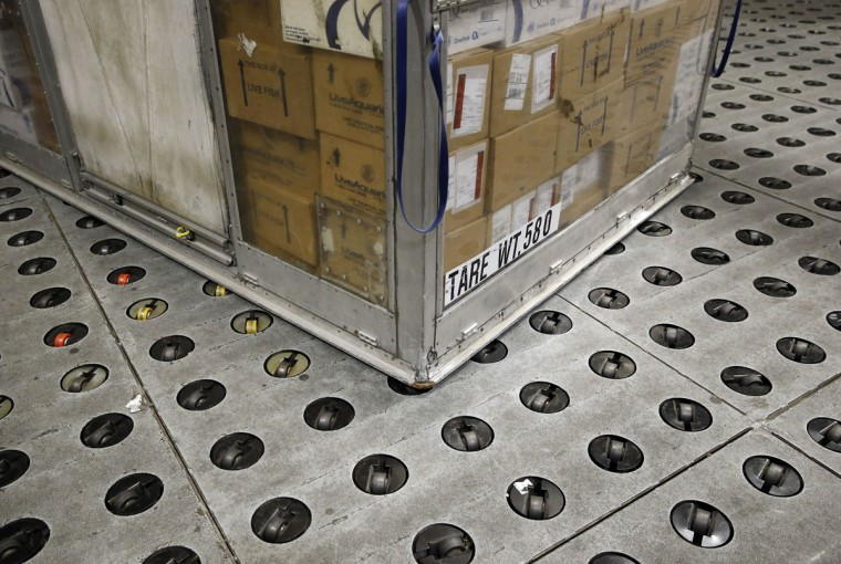 A container sits on a floor containing casters -- to help make the heavy containers easier to move -- at UPS' Worldport facility in Louisville, Ky. (AP Photo/Patrick Semansky)