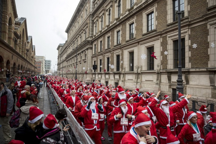 People wearing Santa Claus costumes participate in the Santa Run in Budapest, Hungary, Sunday, Dec. 6, 2015. (Balazs Mohai/MTI via AP)