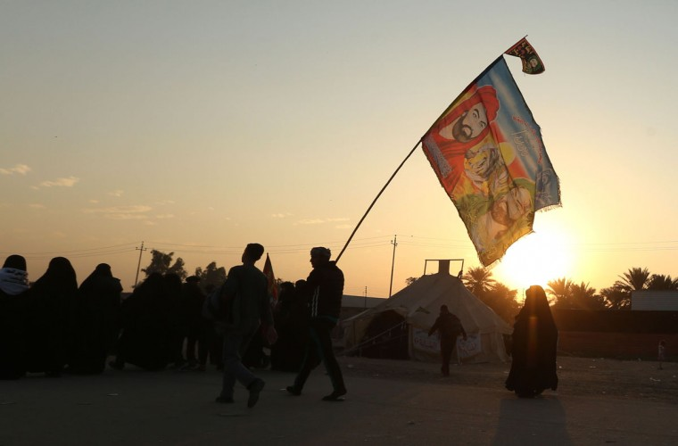 In this Sunday, Nov. 29, 2015, photo, Shiite pilgrims march to Karbala during the Arbaeen ritual in Baghdad, Iraq. (AP Photo/Hadi Mizban)