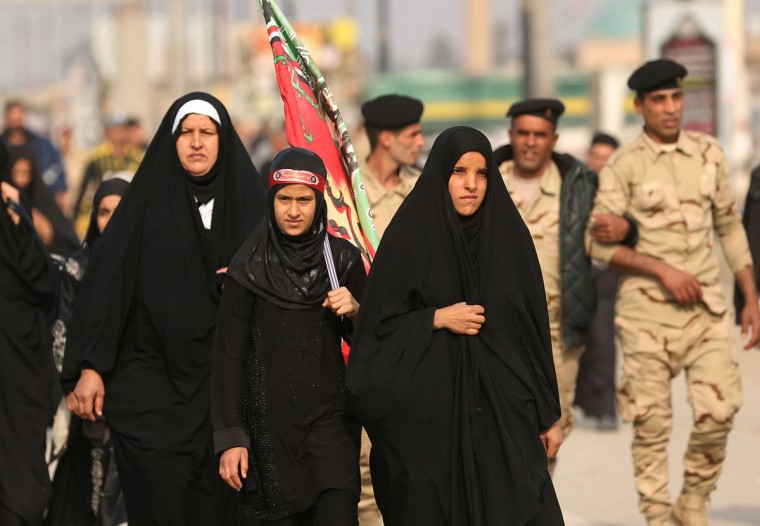 Shiite pilgrims march to Karbala for the Arbaeen ritual in Baghdad, Iraq, Tuesday, Dec.1, 2015. (AP Photo/Hadi Mizban)