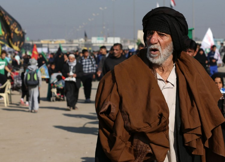 Shiite pilgrims march to Karbala during the Arbaeen ritual in Baghdad, Iraq, Sunday, Nov. 29, 2015. (AP Photo/Hadi Mizban)