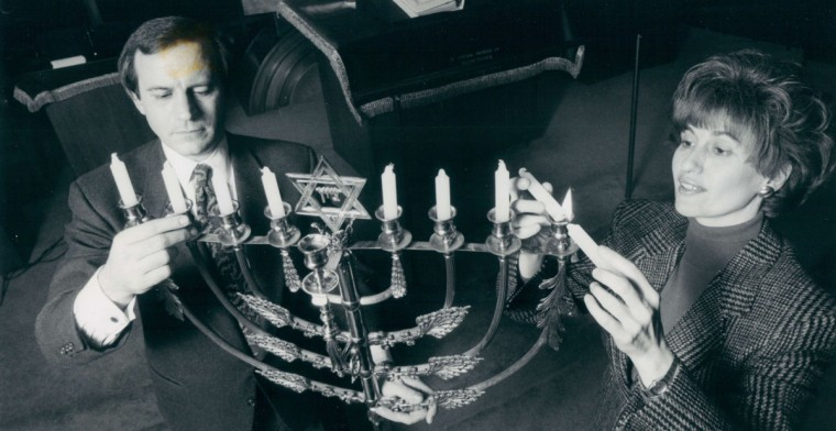 A Beth Tfiloh Congregation, Rabbi Mitchell Wohlberg and Zipora Schorr ready the menorah for the celebration of Hanukkah. (Jed Kirschbaum/Baltimore Sun, 1990)