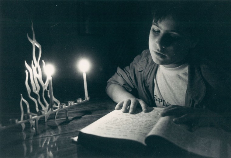 Les Raymond, 9, preps for Hanukkah ceremony. (Baltimore Sun, 1986)