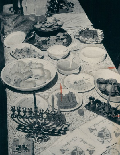 A Hanukkah table setting arranged at the home of Oscar Bonny was part of the holiday tour held in Charles Village. One of the menorahs was an oil-burning type. Debra Bowden prepared the symbolic food including potato latkes. (William Mortimer/Baltimore Sun, 1978)