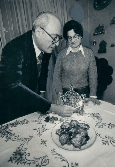 Irving Abramowitz lights a menorah as Grace, his wife, watches. (Ralph L. Robinson/Baltimore Sun, 1979)