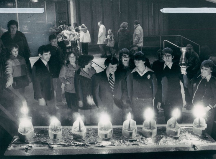 The lighting of the first candle begins the celebration by Jews of Hannukah. In this case, the candles on the menorah at Temple Beth Tfiloh are railroad flares. (Ralph L. Robinson/Baltimore Sun, 1979)