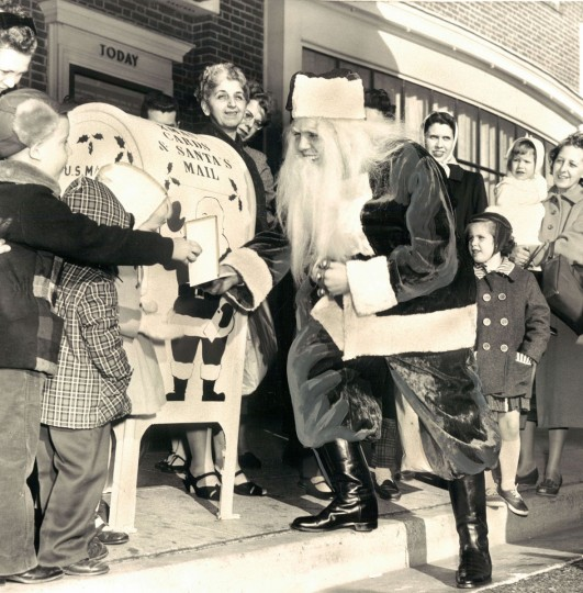 This Santa Claus not only brings things, he comes and get them too. The Post Office sends Santa to 16 mail boxes to collect the mail. If the kids are there when Santa arrives, they can give him their mail in person. (Baltimore Sun, 1959)