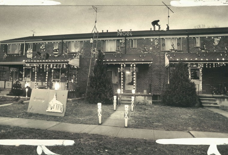 Residents of the 1100 block of Boxwood lane, in the Essex area, have cooperated in setting up a Christmas display that has Santa and his reindeer spanning five porch-tops. (Richard Childress/Baltimore Sun, 1971)