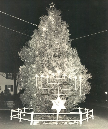 Colonial Villagers, in Pikesville, have celebrated Christmas and Hanukkah jointly for ten years at Christmas Eve meeting with symbolic tree and menorah. (Richard Childress/Baltimore Sun, 1964)