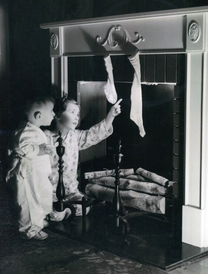 Louisa, age 5, and her younger brother Will Schuring at 4006 Parkside Drive double-check to make sure there is no Christmas Eve fire burning and that their father left the flu open so Santa and his booty can safely make a trouble free passage from roof to parlor in 1939. (Baltimore Sun)
