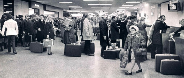 Passengers check in for flights at Friendship Airport two days before Christmas in 1971. The busiest pre-Christmas time at the airport, according to past experience, are the two days preceding the holiday. Most of the additional planes are scheduled then and long queues form. Similar sights can be seen at Greyhound and Trailways stations and at Baltimore's Pennsylvania station as the season of goodwill brings some visitors with gifts to the city and takes others away. (Richard Childress/Baltimore Sun)