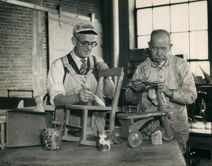 J. Benjamin Ayres, left, and H.G. Murray repair toys at the Good Will Industries shop in Baltimore in 1933. (A. Aubrey Bodine/Baltimore Sun)