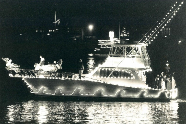 Boats strut their stuff around city dock during the annual parade of lights in downtown Annapolis in 1988. (Karl Merton Ferron/Baltimore Sun)