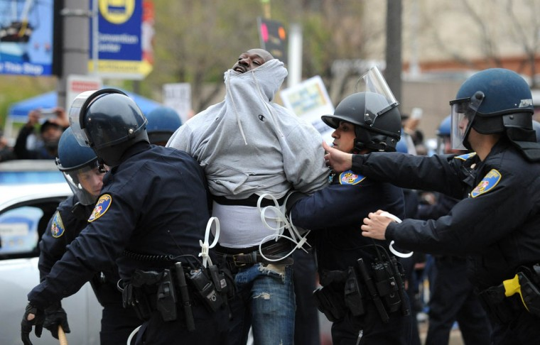 Baltimore police officers take a protester into custody at Pratt and Howard during Saturday's Freddie Gray protest. (Jerry Jackson/Baltimore Sun)
