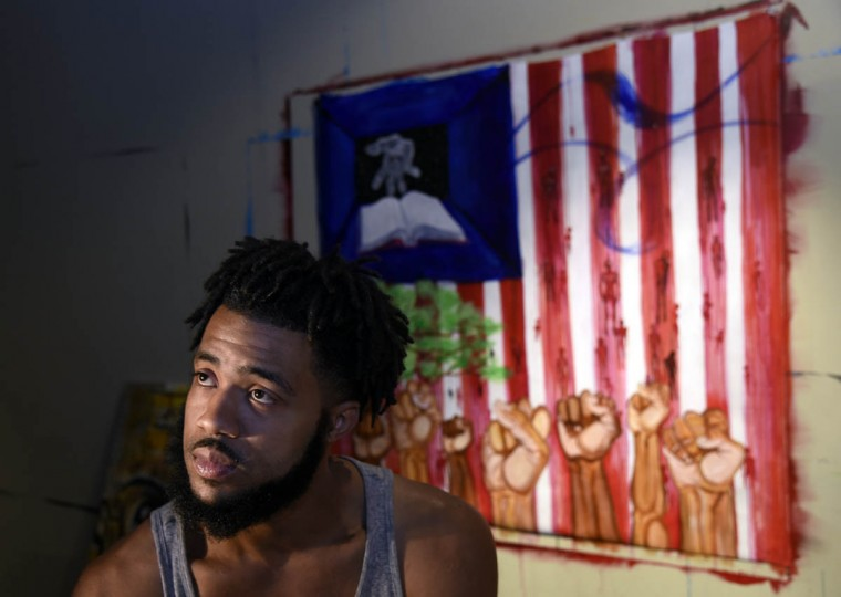 This is artist Aaron Maybin in his home studio in Canton. He was once a football player at Mt. Hebron HS and was a first-round NFL draft player. (Barbara Haddock Taylor, Baltimore Sun)
