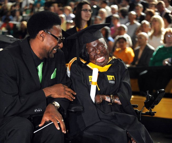 Jacqueline Miller, 24, is graduating from Towson University with a bachelor's degree in English. When she was 5 years old, she was rescued from a house fire by passerby Ted Sutton, left. Jacqueline was badly burned and lost her hands in the fire and uses a wheelchair. She reconnected with Sutton -- a former trouble maker who had just started turning his life around when he rescued her -- about a year ago. (Algerina Perna, Baltimore Sun)