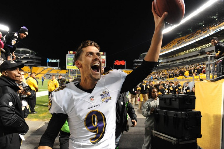 Ravens' Justin Tucker walks off the field with the ball after kicking the game winning field goal in overtime of the Ravens game against the Steelers at Heinz Field in Pittsburgh. (Kenneth K. Lam/Baltimore Sun)