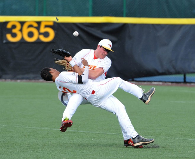 Second baseman Gabriel Nieto #12, front and outfielder Nate Bosse #19 collide as they both go after a fly ball in the second inning. Archbishop Spalding High School plays Calvert Hall in baseball at Calvert Hall. (Algerina Perna, Baltimore Sun)