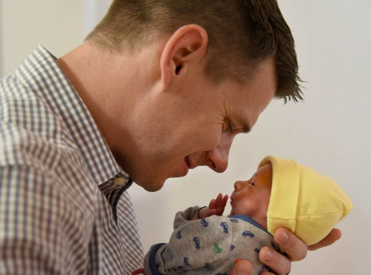 Thomas Hewitt Jr., 33, interacts with Finn after a diaper change. Hewitt and his wife, Kristen, are the parents of naturally-conceived identical triplets on October 21, 2015, in Baltimore. (Amy Davis, Baltimore Sun)