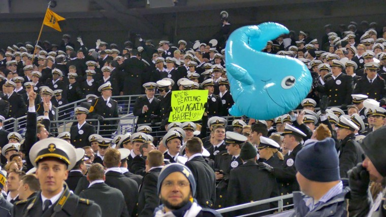 An inflatable whale is batted about during the 115th Annual Army Navy game Saturday, Dec 13, 2014. The Midshipmen sank the Black Knights, 17-10. (Karl Merton Ferron / Baltimore Sun)